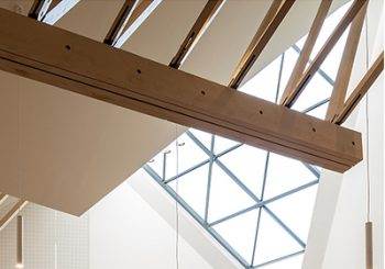 Interior photo of roof structure and triangular window at Monifieth Church